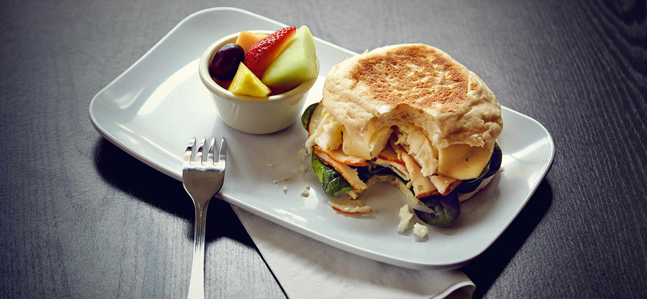breakfast sandwich and fruit